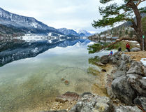 Alpine winter lake view and family Royalty Free Stock Images