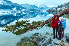 Alpine winter lake view and family. Royalty Free Stock Image