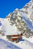 Winter landscape with cabin at Balea Lake and Fagaras Mountains. Alpine winter landscape with cabin at Balea Lake and Fagaras Mountains covered with snow in Stock Photos