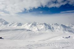 Alpine winter mountain landscape. French Alps with snow. Alpine winter mountain landscape. French Alps covered with snow in sunny day. Val-d`Isere, France Stock Photography