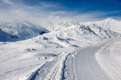 Alpine winter mountain landscape. French Alps with snow. Royalty Free Stock Photo