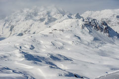 Alpine winter mountain landscape. French Alps with snow. Royalty Free Stock Image