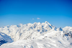 Alpine winter mountain landscape. French Alps with snow. Stock Photo