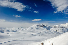 Alpine winter mountain landscape. French Alps with snow. Stock Photos