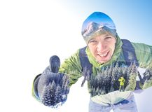 Alpine winter mountaineering. Happy active hiker man showing thumbs up, everything is OK and good. Alpine winter mountaineering. Photography with double exposure Stock Photo