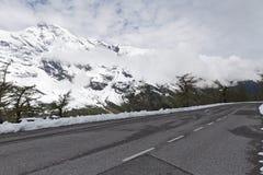 Alpine winter road Stock Photos