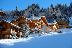 Alpine wooden chalet. In the sunny mountains in winter, Meribel, Three Valleys, France royalty free stock image