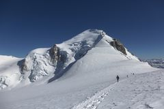 Alpinism expedition team is returning home. Mont Blanc, France. Scenic image of hiking concept. Perfect moment in alpine highlands Royalty Free Stock Photos
