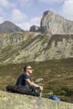 Alpinist размышляет согласно смыслу жизни Стоковое Фото