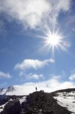 Alpinist. Silhouette of alpinist and sun. Kamchatka.  Russia Royalty Free Stock Photography