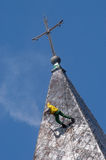 Alpinist cleans church roof Royalty Free Stock Image