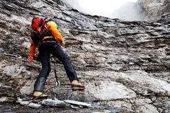 Alpinist climbing Eiger Peak Stock Photography
