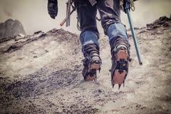 Alpinist climbing on glacier. Extremal sport in mountain, vintage photo Stock Photo