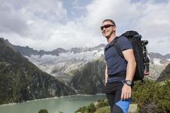 Alpinist enjoys the beautiful landscape in the Swiss mountains Stock Photo