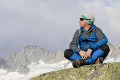 Alpinist enjoys the peace and solitude in the Swiss Alps Stock Photography