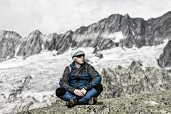 Alpinist enjoys the peace and solitude in the Swiss Alps. Goeschenen Stock Photography