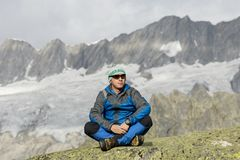 Alpinist enjoys the peace and solitude in the Swiss Alps Royalty Free Stock Photo