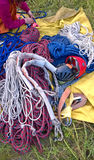 Alpinist equipment. Different alpinist equipment - ropes, helmets, knots laying on the ground close up Stock Photo