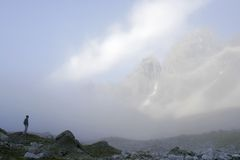 Alpinist in fog (Transbaikal mountains) Stock Photo