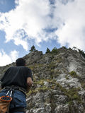 Alpinist help. A alpinist sustaining other alpinist climbing Stock Photography