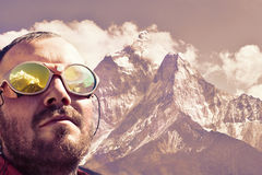 Alpinist looking at summit, mountain background Royalty Free Stock Images
