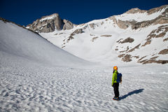 Alpinist looking at the summit to climb Stock Photos