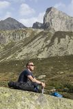 Alpinist meditates according to the meaning of life. In the alps of Switzerland Stock Photo