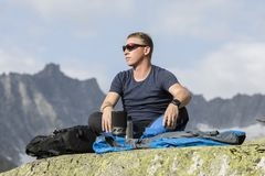 Alpinist meditates according to the meaning of life Stock Images