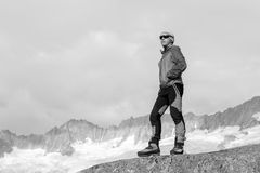 Alpinist meditates according to the meaning of life. In the alps of Switzerland Stock Photography
