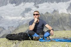 Alpinist meditates according to the meaning of life Stock Photography