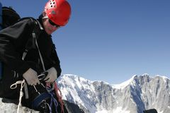 Alpinist and mountain. stock image