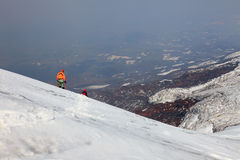 Alpinist on Ostriy Tolbachik volcano. Royalty Free Stock Image