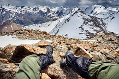 Alpinist sitting on the mountain Stock Photo