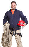 Alpinist smiling with ropes and a helmet. On isolated white background Royalty Free Stock Image