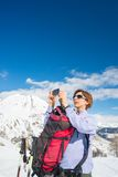 Alpinist taking picture with phone Royalty Free Stock Photography