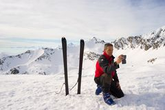 Alpinist taking selfie with smartphone Stock Image