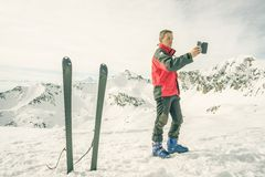 Alpinist taking selfie with smartphone Royalty Free Stock Photography