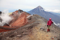 Alpinist on the top of Avachinskiy volcano. Royalty Free Stock Photography