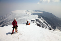Alpinist on the top of Ostriy Tolbachik volcano. Royalty Free Stock Photography
