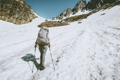 Alpinist woman with backpack climbing to the top of mountain. Traveling lifestyle adventure concept active vacations getaway outdoor hiking sport Stock Image