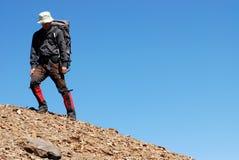Alpinista asiatico Immagini Stock