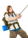 Alpinista che fa un'escursione la montagna rampicante della roccia Fotografie Stock