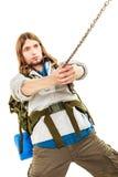 Alpinista che fa un'escursione la montagna rampicante della roccia Immagine Stock