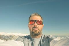 Alpinista che prende selfie Immagine Stock