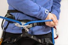 Alpinista con attrezzatura rampicante Immagini Stock Libere da Diritti
