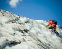 Alpinista de ascensão Imagem de Stock