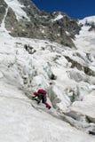Alpinista su neve e su ghiaccio Fotografia Stock Libera da Diritti