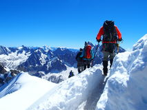 Alpinists in French Alps. Alpinists and Mountain Climbers on Aiguille du Midi in July, Chamonix, Alps, France Royalty Free Stock Photography