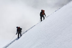 Alpinists on Mont Blanc du Tacul. Climbing alpinists on Mont Blanc du Tacul, France Royalty Free Stock Image