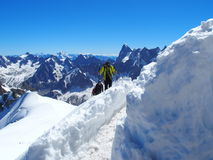 Alpinists and mountaineer climbers in french Alps. Alpinists and mountaineer climber in french ALPS on high alpine mountains range landscape on AIGUILLE DU MIDI Royalty Free Stock Photography